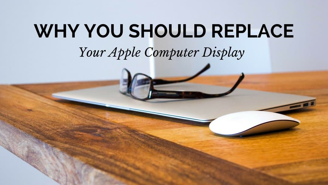 "A photo of an apple laptop and a mouse placed on top of a table with prescription glasses on top of the computer. The words ""Why You Should Replace Your Apple Computer Display"" are displayed at the top of the screen center justified."